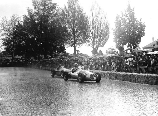 Bremgarten, Basle, Switzerland.25-27 May 1951.Juan Manuel Fangio (number 24, Alfa Romeo 158) prepares to pass Louis Chiron (Maserati 4CLT/48). They finished in 1st and 7th positions respectively.Ref-Autocar C29187.World Copyright - LAT Photographic