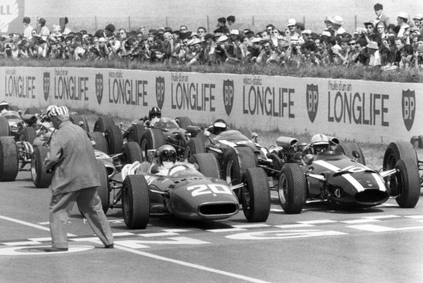 1966 French Grand Prix.Reims, France. 3 July 1966.Lorenzo Bandini, Ferrari 312, not classified, and John Surtees, Cooper T81-Maserati, retired, on the front row before the start, action.World Copyright: LAT PhotographicRef: Motor b&w print