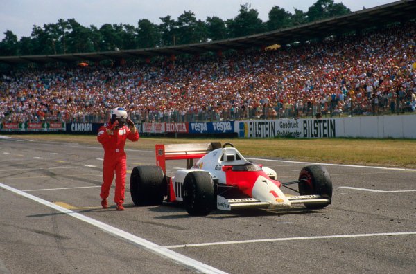 Hockenheim, Germany.25-27 July 1986.Alain Prost (McLaren MP4/2C TAG Porsche) ran out of fuel on the last lap and dropped from 3rd to 6th position, as he pushes his car across the finish line.Ref-86 GER 03.World Copyright - LAT Photographic