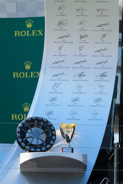 The trophies on the podium.