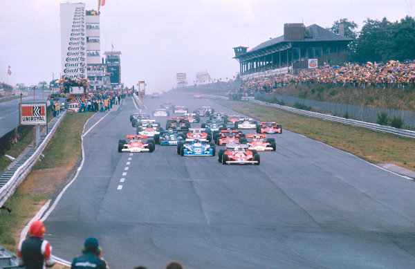 1976 German Grand Prix.Nurburgring, Germany.30/7-1/8 1976.Clay Regazzoni (Ferrari 312T2) leads Jacques Laffite (Ligier JS5 Matra), James Hunt and Jochen Mass (both McLaren M23 Ford's) at the start.Ref-76 GER 03.World Copyright - LAT Photographic