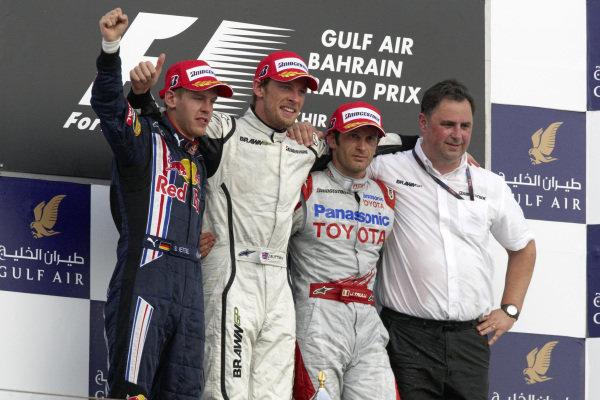 Podium group photo: Sebastian Vettel, 2nd position, winner Jenson Button, Jarno Trulli, 3rd position and Ron Meadows of Brawn GP.
