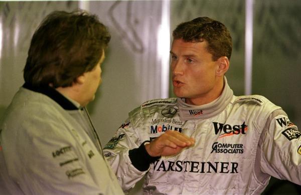 1998 Italian Grand Prix.Monza, Italy.11-13 September 1998.David Coulthard (McLaren Mercedes-Benz) talks to Norbert Haug of Daimler-Benz.World Copyright - LAT Photographic