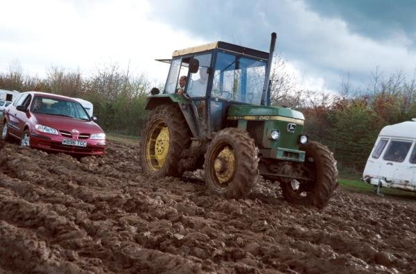 The rain turned the car parks into a quagmire. Many spectators were stuck and had to be towed out of the mud by a tractor.British Grand Prix, Rd4, Silverstone, England. 23 April 2000.