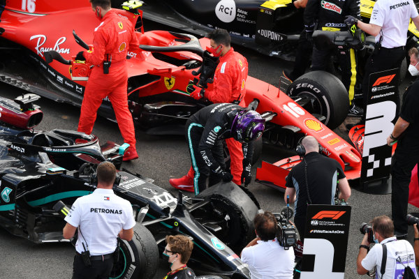 Lewis Hamilton, Mercedes-AMG Petronas F1, 1st position, inspects his puncture in Parc Ferme