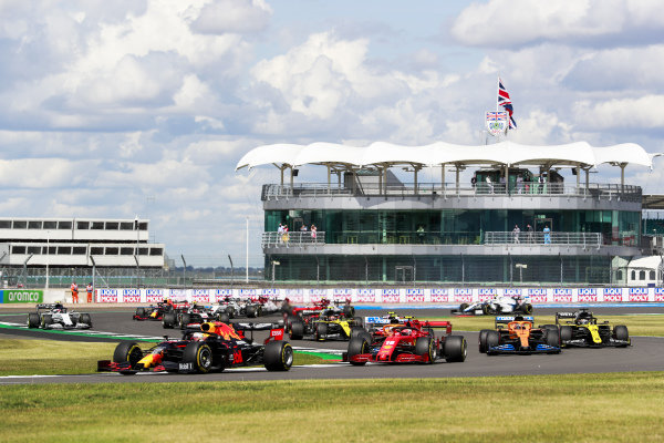 Max Verstappen, Red Bull Racing RB16, leads Charles Leclerc, Ferrari SF1000, Carlos Sainz, McLaren MCL35, Daniel Ricciardo, Renault R.S.20, and the remainder of the field on the opening lap