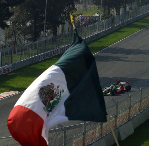 2002 Mexico City CART, 14-17 November, 2002, Autodromo Hermanos Rodriguez, Mexico.Diaz races into the Mexican flag-2002, Grupo Reforma, MexicoLAT Photographic