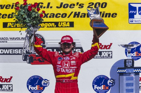 Alex Zanardi, 1st position, celebrates on the podium.