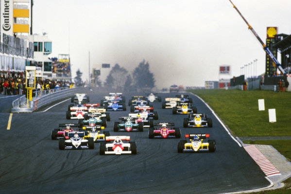 Alain Prost, McLaren MP4-2 TAG, leads Patrick Tambay, Renault RE50, and Nelson Piquet, Brabham BT53 BMW, into the first corner.