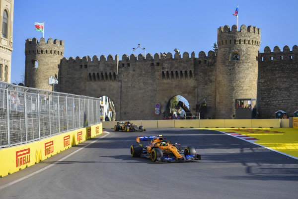 Carlos Sainz Jr., McLaren MCL34, leads Romain Grosjean, Haas VF-19