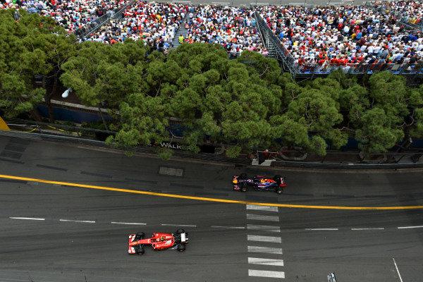 Kimi Raikkonen (FIN) Ferrari F139 and Sebastian Vettel (GER) Red Bull Racing RB10.Formula One World Championship, Rd6, Monaco Grand Prix, Race, Monte-Carlo, Monaco, Sunday 25 May 2014.