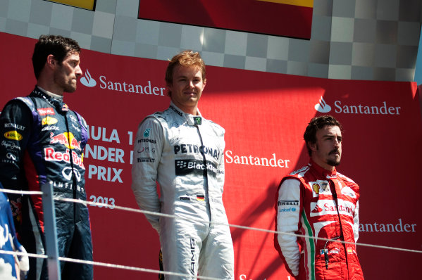 Silverstone, Northamptonshire, England 30th June 2013 Mark Webber, Red Bull Racing, 2nd position, Nico Rosberg, Mercedes AMG, 1st position, and Fernando Alonso, Ferrari, 3rd position, on the podium World Copyright: Chris Bird/  ref: Digital Image _CJB6740