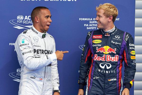 Spa-Francorchamps, Spa, Belgium. 24th August 2013. Front row starters Lewis Hamilton, Mercedes AMG, and Sebastian Vettel, Red Bull Racing. World Copyright: Steve Etherington/LAT Photographic. ref: Digital Image SNE23379 copy.