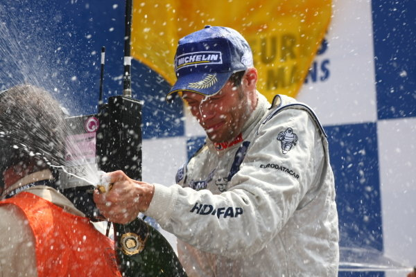 Circuit de La Sarthe, Le Mans, France.8th - 14th June 2009. Alex Wurz, No 9 Peugeot 908 HDi, 1st overall, gets blasted with champagne on the podium. Portrait. Podium. World Copyright: Kevin Wood/LAT Photographic Photographic Ref: IMG_7118 JPG