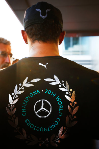 Sochi Autodrom, Sochi, Russia. Sunday 12 October 2014. Lewis Hamilton, Mercedes AMG, 1st Position, with his shirt celebrating the 2014 Constructors title the team secured in Russia. World Copyright: Andy Hone/LAT Photographic. ref: Digital Image _ONY8878