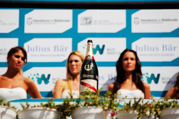2014 FIA Formula E Championship. Punta del Este ePrix, Uruguay. Podium, Mumm champagne. Photo: Zak Mauger/LAT/FE ref: Digital Image _MG_0107
