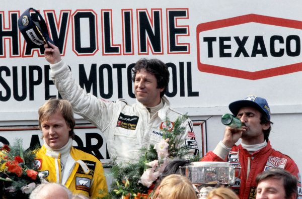 Zolder, Belgium. 19 - 21 May 1978. Mario Andretti (Lotus 79-Ford) 1st position, with Ronnie Peterson (Lotus 79-Ford), 2nd position and Carlos Reutemann (Ferrari 312T3) 3rd position on the podium, portrait.  World Copyright: LAT Photographic. Ref: 78BEL06