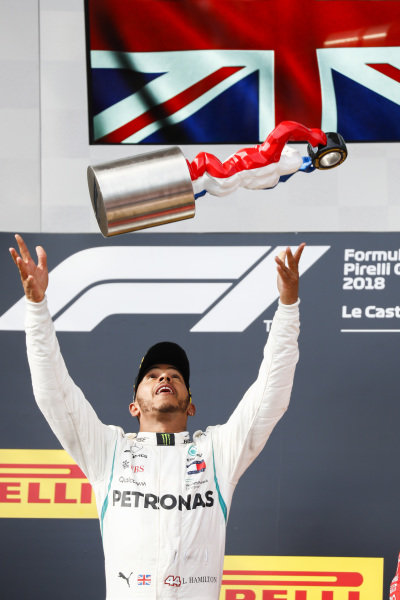 Lewis Hamilton, Mercedes AMG F1, 1st position, on the podium with his trophy.