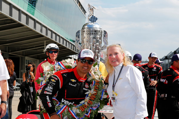 24 May, 2015, Indianapolis, Indiana, USA Juan Montoya poses with Chevrolet PR ace Judy Dominick ?2015, Phillip Abbott LAT Photo USA