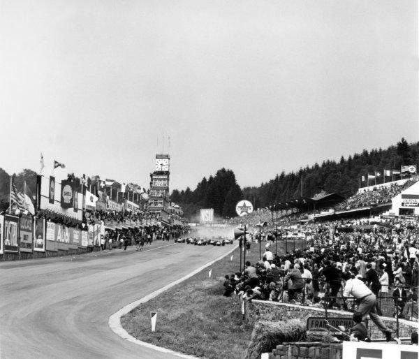 1966 Belgian Grand Prix.Spa-Francorchamps, Belgium. 12 June 1966.Jochen Rindt, Cooper T81-Maserati, 2nd position, and John Surtees, Ferrari 312, 1st position, lead at the start, action.World Copyright: LAT PhotographicRef: 34878