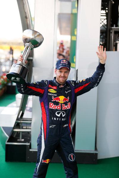 Suzuka Circuit, Suzuka, Japan.  Sunday 13th October 2013. Sebastian Vettel, Red Bull Racing, 1st position, leaves the podium with his trophy.  World Copyright: Steven Tee/LAT Photographic  ref: Digital Image _C3I1221