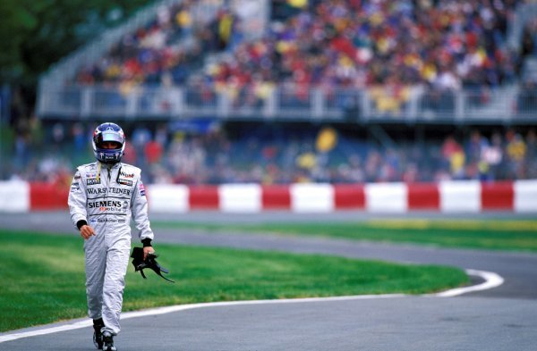Kimi Raikkonen (FIN) McLaren walks back to the pits after a qualifying error that relegated him to the back of the grid. He charged through the field to finish sixth, but lost his championship lead as a result. Canadian Grand Prix, Rd 8, Montreal, 15 June 2003. BEST IMAGE
