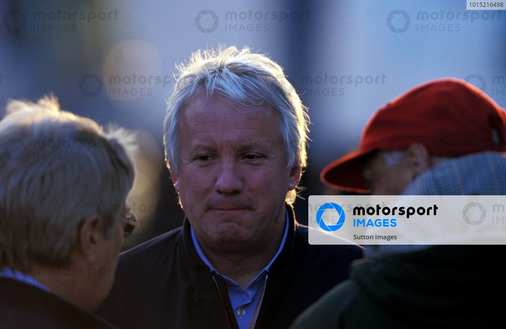 Charlie Whiting (GBR) FIA Safety Delegate and Official Race Starter talks with Herbie Blash (left, back to camera) and Niki Lauda (AUT, right back to camera). Formula One World Championship, Rd4, San Marino Grand Prix, Imola, Italy, 15 April 2001.