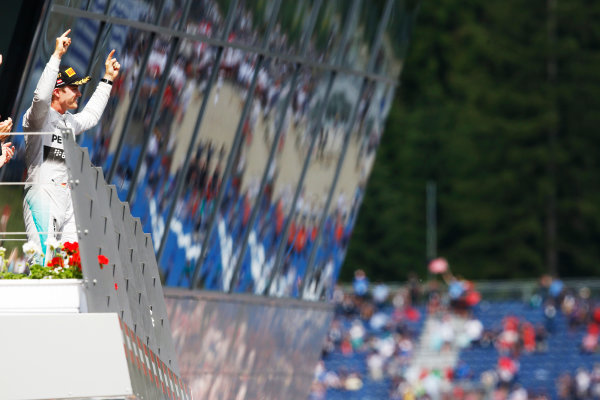 Red Bull Ring, Spielberg, Austria. Sunday 22 June 2014. Nico Rosberg, Mercedes AMG, 1st Position, celebrates on the podium. World Copyright: Steven Tee/LAT Photographic. ref: Digital Image _X0W0900