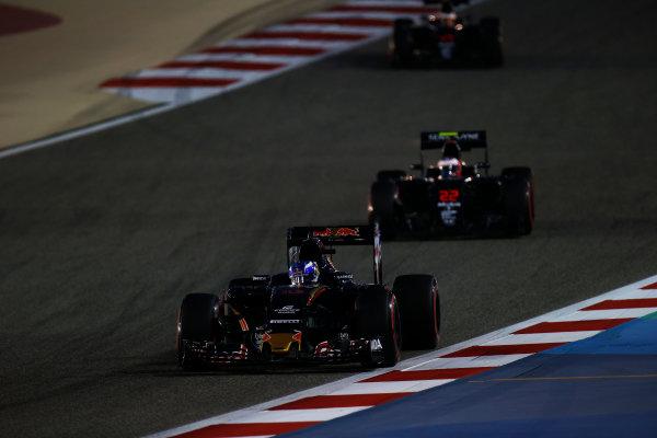 Bahrain International Circuit, Sakhir, Bahrain. Sunday 3 April 2016. Max Verstappen, Toro Rosso STR11 Ferrari leads Jenson Button, McLaren MP4-31 Honda. World Copyright: Sam Bloxham/LAT Photographic ref: Digital Image _L4R9306