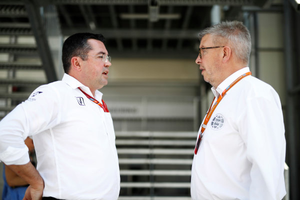 Baku City Circuit, Baku, Azerbaijan. Sunday 25 June 2017. Ross Brawn, Managing Director of Motorsports, FOM, talks to Eric Boullier, Racing Director, McLaren.  World Copyright: Glenn Dunbar/LAT Images ref: Digital Image _31I1838