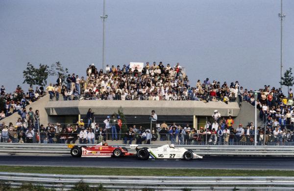 Alan Jones, Williams FW07 Ford leads Gilles Villeneuve, Ferrari 312T4.