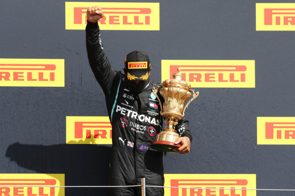 Lewis Hamilton, Mercedes-AMG Petronas F1, 1st position, on the podium with his trophy