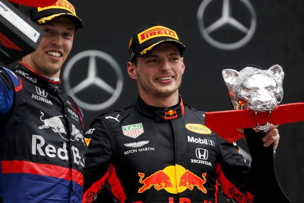 Daniil Kvyat, Toro Rosso and Race winner Max Verstappen, Red Bull Racing on the podium with the trophy