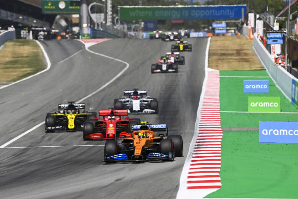 Lando Norris, McLaren MCL35, leads Sebastian Vettel, Ferrari SF1000, Daniel Ricciardo, Renault R.S.20, and Daniil Kvyat, AlphaTauri AT01