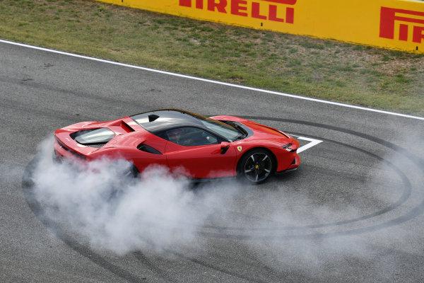 Sebastian Vettel, Ferrari, performs donuts in a SF90 Stradale