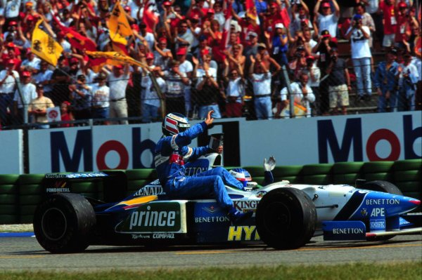 1996 German Grand Prix.Hockenheim, Germany.26-28 July 1996.Jean Alesi (Benetton B196 Renault) 3rd position, gives Gerhard Berger a lift back the pits after Berger retired while leading.World Copyright - LAT Photographic