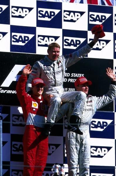 Podium and results: 1st Mika Hakkinen (FIN) McLaren, centre 2nd Michael Schumacher (GER) Ferrari, left. 3rd David Coulthard (GBR) McLaren, right. United States Grand Prix, Indianapolis, 30 September 2001 BEST IMAGE