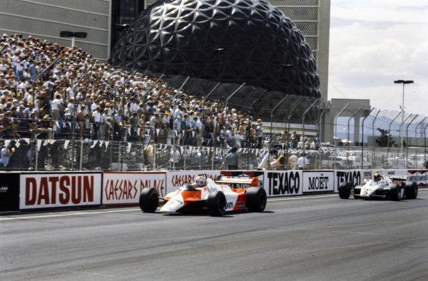 John Watson, McLaren MP4-1B Ford, leads Derek Daly, Williams FW08 Ford.