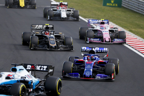 George Russell, Williams Racing FW42, leads Daniil Kvyat, Toro Rosso STR14, Kevin Magnussen, Haas VF-19, and Lance Stroll, Racing Point RP19