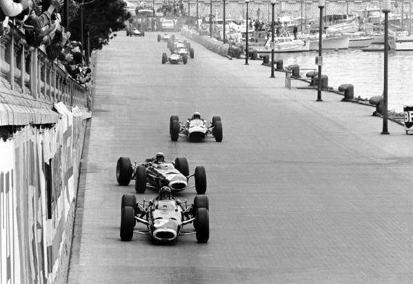 Monaco GP   30 May 1965  Lap 1:  Winner Graham Hill BRM P261 leads a sideways Jackie Stewart(3rd) BRM P261 and Lorenzo Bandini(2nd Ferrari 1512