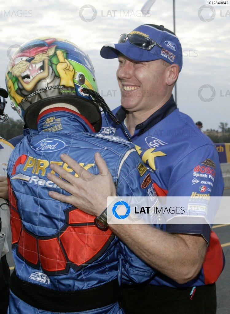 2004 Australian V8 Supercarsrd 6, Queensland Raceway, Brisbane. 4th July.Winner Marcos Ambrose gets a hug from his team.World Copyright: Mark Horsburgh/LAT Photographicref: Digital Image Only