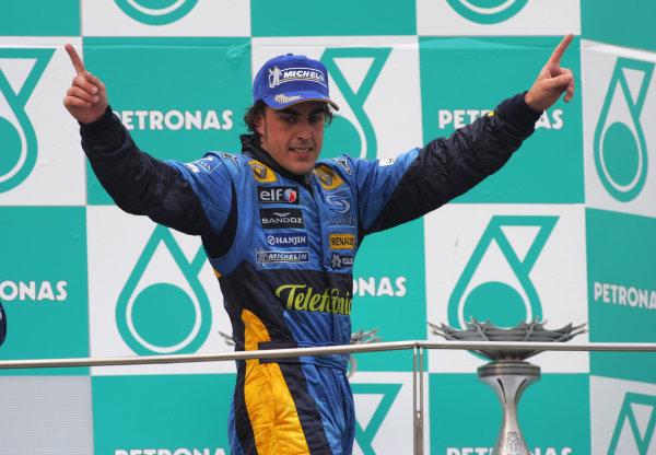 2005 Malaysian Grand Prix - Sunday Race, Sepang, Kuala Lumpur. Malaysia. 20th March 2005 Race podium - winner Fernando Alonso, Renault R25 (1st), celebrates.World Copyright: Steve Etherington/LAT Photographic ref: 48mb Hi Res Digital Image Only