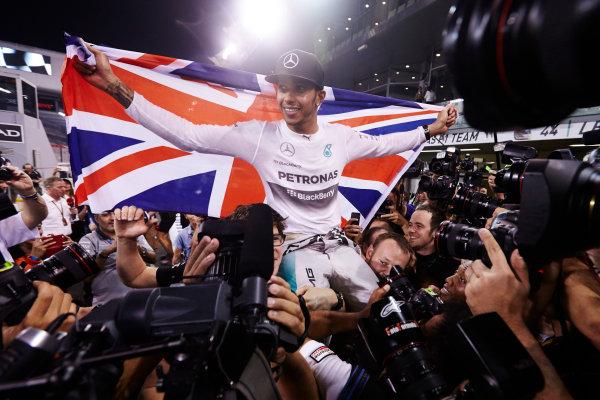 Yas Marina Circuit, Abu Dhabi, United Arab Emirates. Sunday 23 November 2014.  Lewis Hamilton, Mercedes AMG, celebrates championship victory.  World Copyright: Steve Etherington/LAT Photographic. ref: Digital Image SNE13425