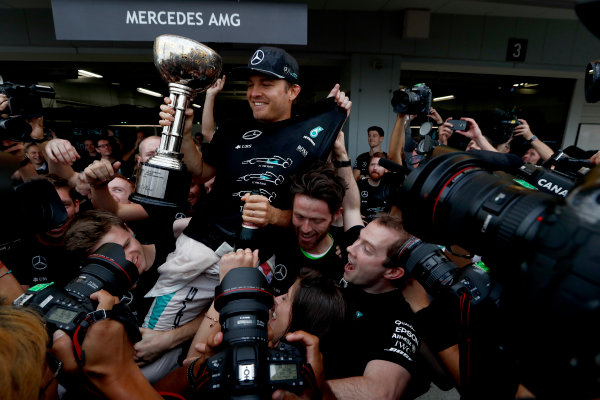 Suzuka Circuit, Japan. Sunday 9 October 2016. Nico Rosberg, Mercedes AMG, 1st Position, and the Mercedes AMG team celebrate securing their 3rd consecutive constructors title. World Copyright: Dunbar/LAT Photographic ref: Digital Image _X4I8761
