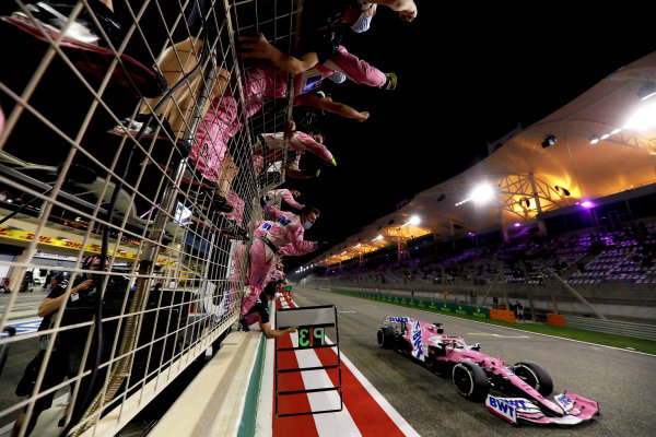 Sergio Perez, Racing Point RP20, 1st position, crosses the line for victory to the delight of his team