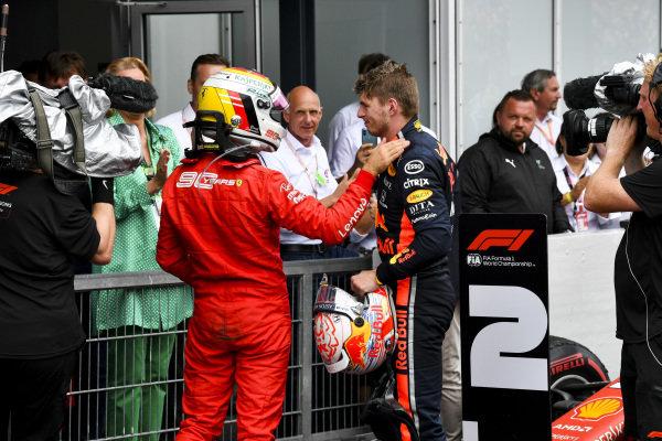 Sebastian Vettel, Ferrari and Race winner Max Verstappen, Red Bull Racing celebrate in Parc Ferme