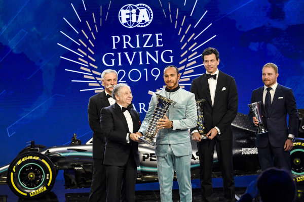 Lewis Hamilton with Toto Wolff, Valtteri Bottas, Chase Carey and Jean Todt