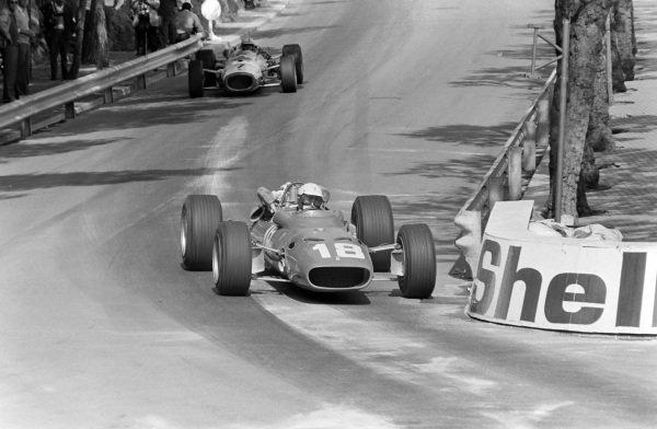 Lorenzo Bandini, Ferrari 312, leads John Surtees, Honda RA273.