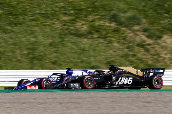 Romain Grosjean, Haas VF-19 and Daniil Kvyat, Toro Rosso STR14
