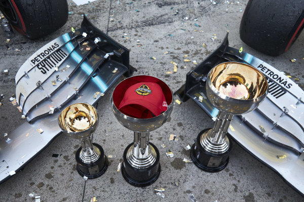 Niki Lauda's Parmalat cap sits in one of the Japanese Grand Prix trophies